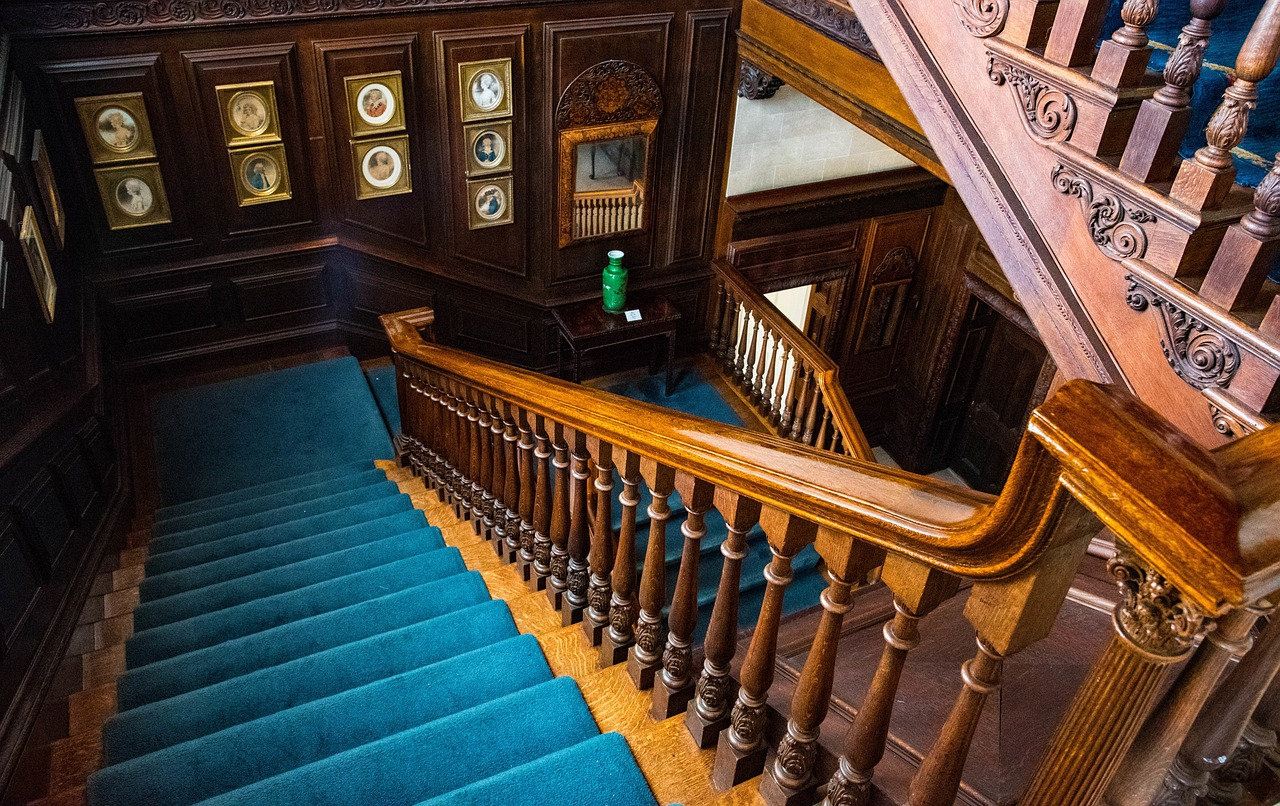 Stunning century home with a richly detailed wood staircase.