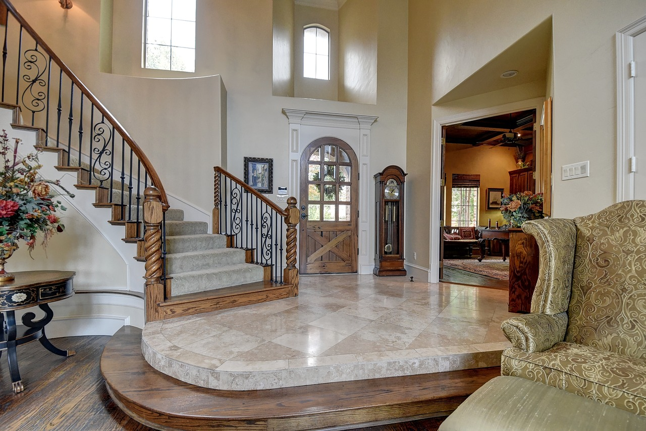 Carved oak staircase with wrought iron balusters