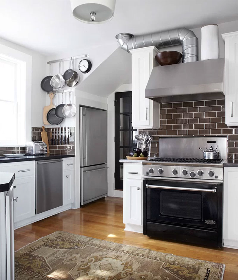 Exposed Pipe & Faux Brick Kitchen