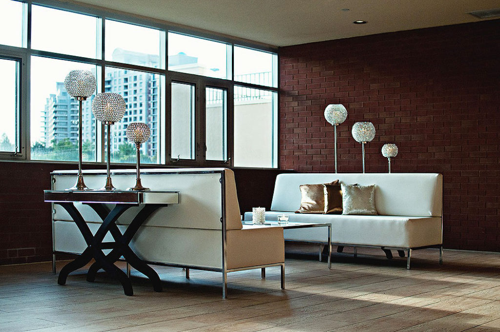 Sleek Living Room with Deep Red Exposed Brick Wall