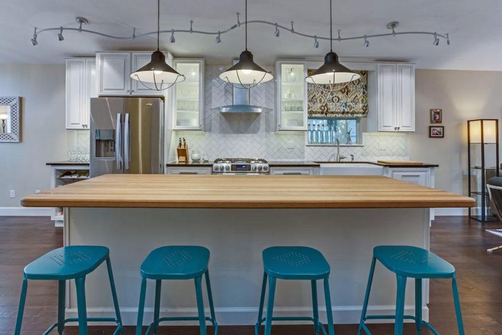 Pop of Blue in an Industrial Kitchen