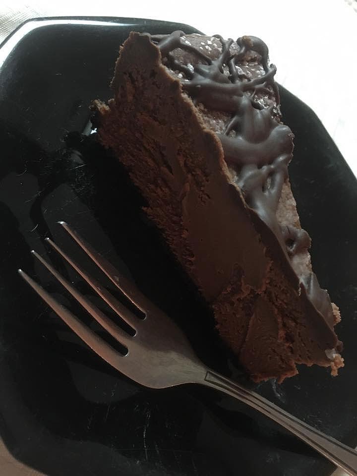 A slice of dark chocolate cheesecake