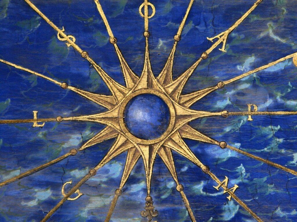 Gold Compass Rose on Blue Background